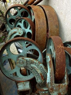 rusty-pulleys. This look can be achieved with Modern Masters iron and copper oxidizing paints. SK Sartell