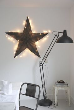 © kitchen wall  big black lamp Industrial star with christmas lights Tolix