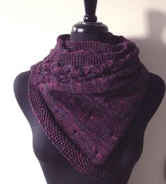 """This shawl or stole features rows of eyelets and a panel of lacy cables off to one side (no additional cable holder is needed). Noctis' design reminds me of stars and swirling galaxies and the dark shade of the shawl brings to mind the night. Noctis actually means """"of night"""" in Latin."""