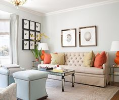 Sky blue walls and pops of orange liven up this  living area. More living room design ideas: http://www.bhg.com/rooms/living-room/makeovers/living-room-decorating-ideas/?socsrc=bhgpin091313skybluewalls&page=30