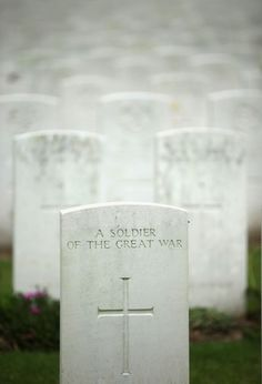 The headstone of an unknown soldier sits amongst thousands of others buried in Hooge Crater Military Cemetery in Ypres, Belgium