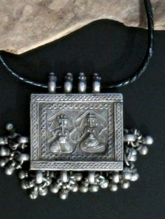 Beautifully kept large antique Silver Pendant from Northern India showing Ganesha with his mother Parvati. Handcrafted early 1900's.