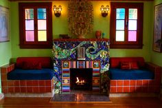 Consider the whimsy that frames the hearth in David Edward Byrd and Jolino Beserra's 1928 Spanish bungalow. Clothed in broken ceramics and found and treasured objects, the fireplace resembles an outsize toy. The swirled mosaic pattern and jumble of shiny fun make one suspect it's crowded with spirits.