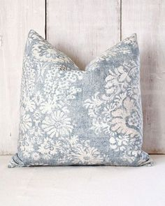 Perfect for your cottage, traditional or beach decor, this faded denim blue damask pillow cover is so pretty! A blue and beige damask pattern scrolls across a vintage looking denim blue background. This blue floral pillow cover has an envelope back of the same fabric. Pattern placement will vary, but will be equally beautiful!  This blue and tan throw pillow cover is crafted with care. All inner raw edges are professionally serged to prevent fraying. Stress points are triple stitched. Pillow…