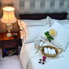 Feel the #hotel #luxury to your home with this Beaumont & Brown #bedlinen. Visit our showroom to see more of our collections.  #candle #flowers #headboard