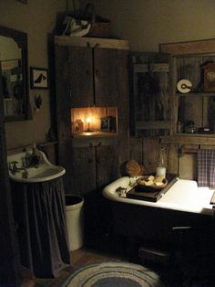 Primitive bathroom. (This decor would be so cute - on a much smaller scale - in a powder room!)  Maybe even add one of those toilets with the water tank that hangs above the toilet with the pull chain!