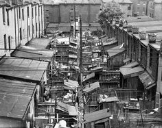Baltimore backyards before sewage. Outhouses were in the far end of the yard. My grandmother's house , where she grew up on Woodyear St., had one. When the sewers came they put a toilet & bathtub in the back bedroom.