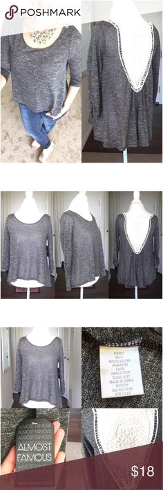 """Beautiful 😍Gray Crochet Back Hi Low Top Beautiful 😍Gray Crochet Back Hi Low Top by Almost Famous. Tunic style. Size medium. Polyester, rayon and cotton blend. Crochet back is ivory in color. Measurements are; armpit to armpit 20"""", 3/4 sleeve and length is back 26"""" and front is 20"""". All my items are from a smoke free environment. Almost Famous Tops Tunics"""