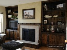 Built-Ins around a fireplace.  Living room cabinets to hide all the clutter.  The thick glass shelving as compared to wood shelves is nice too.  www.mancaveinvaded.com living room - cabinets - built ins - alder wood.