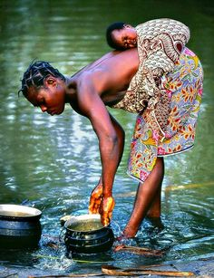 Water from the River of Life - Mother and Baby in Africa - Photographer Sergio Pessolano