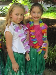 """Luau Birthday Party Ideas - Even the party games followed the theme. The kids enjoyed playing hot coconut, the limbo, pineapple pineapple coconut (played like duck, duck, goose), and bowling using a """"coconut"""" and water bottles filled with pretty glittery water."""