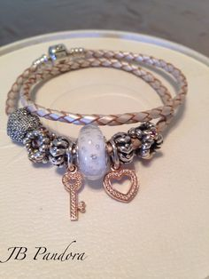 Pandora champagne leather bracelet. 14kt Rose love and trust symbols. White effervescent murano. Ready for spring.  4/12/15
