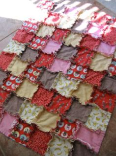 Simply Rag Quilt Approximate Finished Size: 44 inches by 34 inches What You'll Need: Sewing Machine 7/8 yard each of seven different types of flannel Thread Rotary Cutter and Cutting Board (optional) Measuring Device for Cutting Squares Sharp Scissors Leather Glove (optional)