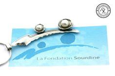 Création d'un pendentif en argent et perle.