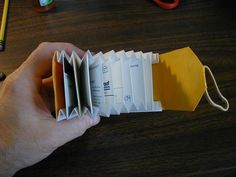 Accordion-Style Card Wallet make out of tyvek for holding cards but if you use an altoids tin to it you can put the bills on top or if u only glue the end of the accordian the very edge you can pick up the accordian and have hidden bills! Origami Wallet, Sew Wallet, Origami Envelope, Card Wallet, Diy Accordion Wallet, Accordion Book, Cardboard Crafts, Paper Crafts, Diy Wallet Cardboard