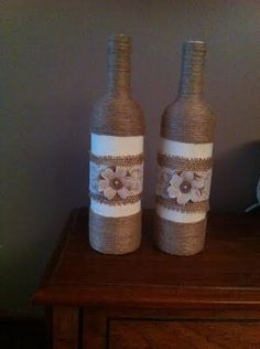Repurposed wine bottle incorporates many elements. Painted off white with twine, burlap, off white lace and burlap flower. Can hold single stem or