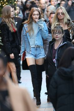 Gigi Hadid denim on denim with a grey hoodie and over the knee black suede boots
