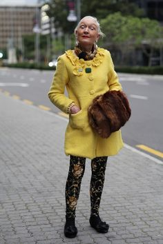 ADVANCED STYLE:   Love her playful stylishness. Makes me think about the CAbi pink coat and its unexpected uses.