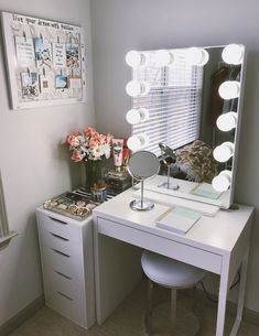 Cute vanity set up perfect for small places. I purchased the mirror from Impressions Vanity and the desk and drawers from IKEA