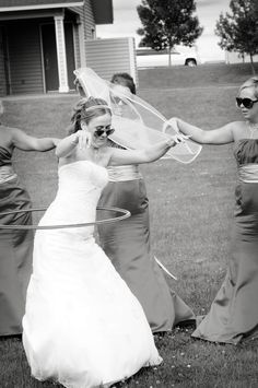 Hula hooping in a wedding dress is an art. Photo by Troy #minneapolisweddingphotographers
