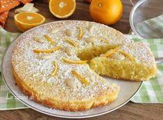 Caprese all'arancia e cioccolato bianco torta profumata e golosa con mandorle cioccolato bianco e succo e buccia di arancia, senza farina e senza burro
