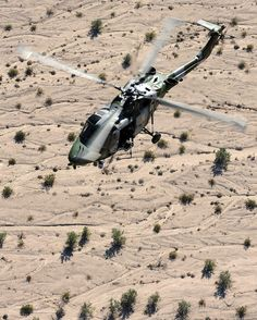 A Lynx Mk9A helicopter with 847 Naval Air Squadron flying over the desert training areas surrounding Naval Air Facility El Centro in California, USA.