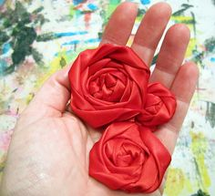 How to make a rolled rose out of fabric, ribbon.  You don't have to sew, you can use a glue gun if preferred.  I am making a bunch of these for some projects I am doing.