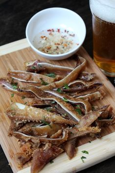 Crispy Pig's Ears Cooked Sous-vide in Coconut Oil Confit, then Deep Fried by @Marvin Gapultos. Crispy on the outside, tender on the inside!