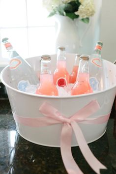April Showers baby shower party: sparkling water and pink Izzie drinks to match the color palette  {Style Me Pretty Living}