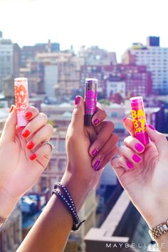 "The perfect backdrop to your favorite lip balm, the city you love. Baby Lips Crystal, a different tint for every complexion, or every mood. Choose your favorite shade, or opt for a formula that automatically ""blooms"" on your lips to your perfect pink."