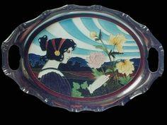 Landscape tile, Art Nouveau maiden picking flowers. Carl Sigmund Luber for Johann von Schwarz ceramic company, Nürnberg, Germany, c. 1902, oval tile in nickel-plated frame.