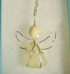 A sweet angel made with sea glass I found in Hawaii and wrapped with sterling silver wire. It is sure to be a special gift for the angel in