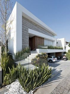 I like the mix of materials and different textures (building and garden).