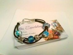 Check out this item in my Etsy shop https://www.etsy.com/listing/216004190/beachy-bohemian-blue-and-leather
