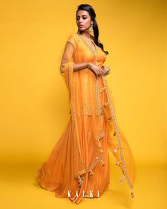 All the to-be-brides & newly weds can don this blazing palazzo ensemble which speaks the warm tone of sunset. Be it a work festive party or a family get together, this sun-orange outfit screams celebration. Flared Palazzo, Palazzo Pants, Orange Fashion, Indian Fashion, Women's Fashion, Mirror Work Saree Blouse, Sarara Dress, Achkan, Ethnic Suit