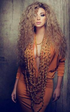 Myriam Fares.. she has some thing I like don't know if it's the hair or the makeup
