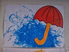Eerst hebben we regn geverft en er daarna een paraplu bij gemaakt.