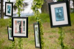Framed Family Photos Hang from a Line at a Country Wedding