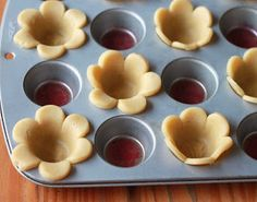 Pretty Food - Use large cookie cutter to cut dough in flower shapes, line a muffin tin or small cupcake tin with cutouts and open them in petal shapes