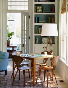 White Fretwork Chairs And Antique Mirrored Panels