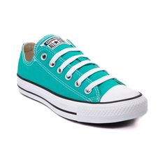 From b-ball courts  to punk clubs. From skateparks to school yards. The Converse All Star has come a long way, and it's ready to take you even further. The original Old School Chucks never lets up. Low top Converse featuring a turquoise canvas upper and rubber sole. Please note that this shoe runs a half size large.    Manufacturer style 144810F