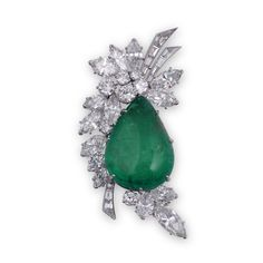 VAN CLEEF & ARPELS. AN EMERALD AND DIAMOND BROOCH Of stylised foliate design, centring on a drop-shaped cabochon emerald within a surround of marquise-, brilliant- and baguette-cut diamonds, 1960s, signed Van Cleef & Arpels and numbered, mounted in platinum