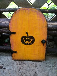 Halloween Decor Ideas Halloween FAIRY DOOR yellow distressed pumpkin #halloween #decor #ideas www.loveitsomuch.com