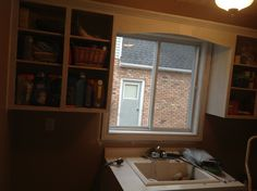 Day 1 - all trim and cupboards cleaned, sanded and I coat of primer