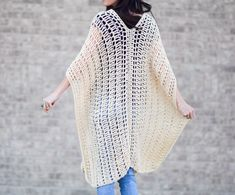 Often times we consider knit and crochet to be winter activities, but some of my all time favorite projects have happened in the summer time! This simple crocheted poncho was so fun to make as it worked up very quickly and it's going to be perfect for warm summer days. The style reminds me of vacation time and it