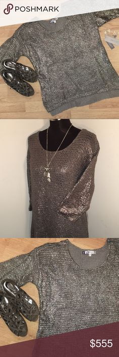 💟 HP🎉NWT 💝 Jennifer Lopez Metallic Swtr Brand new Jennifer Lopez tunic sweater in trendy gunmetal metallic. Large chunky knit, split hem slightly longer in back and 3/4 sleeves. Measures 21 inches from armpit to armpit, 24.5 inches front length, 26 inches back length and sleeves are 12 inches long. Looks very cool with skinnies and boots. 😎 NWT. Smoke free. Thanks and Happy Poshing. 💟 2018 Trends Host Pick 🎉 Thanks Jenny @atlanticpacific 😘💕 Jennifer Lopez Sweaters Crew & Scoop Necks