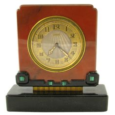 CARTIER Art Deco jasper, black onyx and malachite clock.  US  1920's  A Cartier clock made from jasper with a black onyx base embellished with malachite.