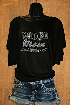 Perfect for the rodeo mom in your life! Find online for $34 at http://www.rhinestonerodeo.com/Rodeo-Mom-Draped-Tee-RR13.htm