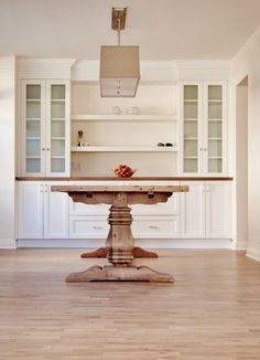 Use the crown molding to disguise the sofit in the dining room, would also need to add something to the side towers to make them stand out from the sofit. Leave out the shelves because the window is in the middle.