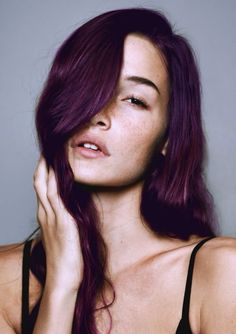 Dark purple hair. Love this! Great for hair like mine: already dark, long  straight, and also all one length with no fringe of any sort. Also looks great on a pale complexion, which also is important to take into account when one has extremely pale yet porcelain, luminous pale skin—not pasty pale skin!